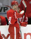 Jeff Hoggan stands at the bench during a stop in play in a Grand Rapids Griffins game.