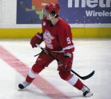 Adam Almquist straddles the center red line during a Grand Rapids Griffins game.