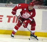 Nathan Paetsch plays the puck along the boards during a Grand Rapids Griffins game.