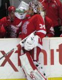 Petr Mrazek stops at the bench for a drink during a stop in play in a Grand Rapids Griffins game.