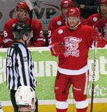 Francis Pare talks to an official during a stop in play in a Grand Rapids Griffins game, with Tomas Jurco on the bench behind him.