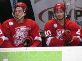 Francis Pare and Gleason Fournier sit on the bench during a Grand Rapids Griffins game.