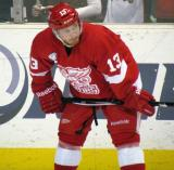 Gustav Nyquist crouches along the boards during a Grand Rapids Griffins game.