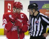 Jeff Hoggan talks to an official during a stop in play in a Grand Rapids Griffins game.