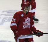 Chad Billins lines up for a faceoff during a Grand Rapids Griffins game.