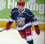 Chad Billins skates near the boards during pre-game warmups before the Grand Rapids Griffins' Purple Game.