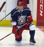 Francis Pare kneels near the boards during pre-game warmups before the Grand Rapids Griffins' Purple Game.