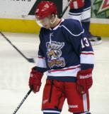 Gustav Nyquist plays with a puck during pre-game warmups before the Grand Rapids Griffins' Purple Game.