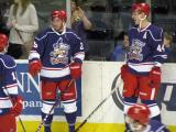 Landon Ferraro and Brennan Evans laugh with Gustav Nyquist during pre-game warmups before the Grand Rapids Griffins' Purple Game.