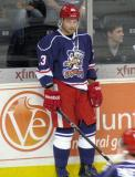 Triston Grant stands along the end boards during pre-game warmups before the Grand Rapids Griffins' Purple Game.