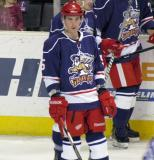 Adam Almquist stands near the bench during pre-game warmups before the Grand Rapids Griffins' Purple Game.