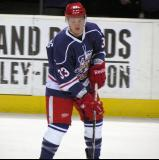 Luke Glendening carries a puck during pre-game warmups before the Grand Rapids Griffins' Purple Game.
