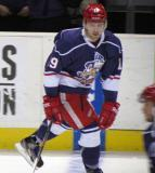 Riley Sheahan skates across the blue line during pre-game warmups before the Grand Rapids Griffins' Purple Game.