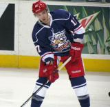 Max Nicastro looks to make a pass during pre-game warmups before the Grand Rapids Griffins' Purple Game.