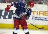 Andrej Nestrasil bounces a puck on his stick during pre-game warmups before the Grand Rapids Griffins' Purple Game.