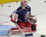 Tom McCollum reaches out with his blocker on a shot during pre-game warmups before the Grand Rapids Griffins' Purple Game.