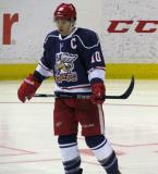 Jeff Hoggan skates back to the bench during a stop in play in the Grand Rapids Griffins' Purple Game.