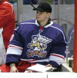 Backup goalie Tom McCollum sits on the bench during the Grand Rapids Griffins' Purple Game.