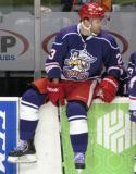 Triston Grant sits on top of the boards at the bench during a stop in play in the Grand Rapids Griffins' Purple Game.