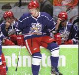 Andrej Nestrasil sits on top of the boards with Francis Pare and Mitch Callahan on the bench behind him during a stop in play in the Grand Rapids Griffins' Purple Game.