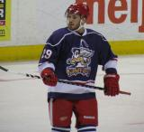 Landon Ferraro checks his stick during a stop in play in the Grand Rapids Griffins' Purple Game.