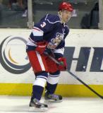 Brett Skinner plays the puck along the boards during the Grand Rapids Griffins' Purple Game.