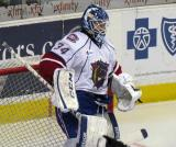 Dustin Tokarski of the Hamilton Bulldogs gets set for the start of the second period of a game against the Grand Rapids Griffins.