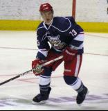 Luke Glendening skates through the left faceoff circle during the Grand Rapids Griffins' Purple Game.