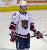 Nathan Beaulieu of the Hamilton Bulldogs waits for a faceoff during a game against the Grand Rapids Griffins.