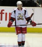 Adam Almquist stands near the bench during pre-game warmups before a Grand Rapids Griffins game.