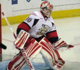 Tom McCollum comes out to the top of the crease to face a shot during pre-game warmups before a Grand Rapids Griffins game.