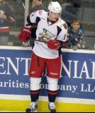 Andrej Nestrasil bounces a puck on his stick during pre-game warmups before a Grand Rapids Griffins game.