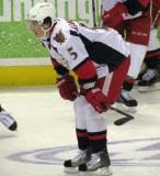 Adam Almquist crouches in the neutral zone during pre-game warmups before a Grand Rapids Griffins game.