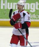 Brett Skinner checks his stick during pre-game warmups before a Grand Rapids Griffins game.