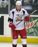 Andrej Nestrasil checks his stick during pre-game warmups before a Grand Rapids Griffins game.