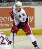 Louis-Marc Aubry looks to take a shot during pre-game warmups before a Grand Rapids Griffins game.