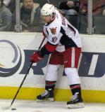 Jeff Hoggan plays the puck along the boards during a Grand Rapids Griffins game.