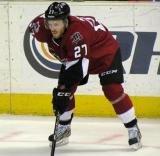 Tyler McNeely of the Lake Erie Monsters gets set for a faceoff in a game against the Grand Rapids Griffins.