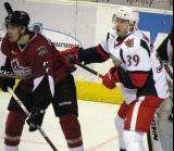 Jan Mursak battles for goal-front position with Markus Lauridsen of the Lake Erie Monsters during a Grand Rapids Griffins game.