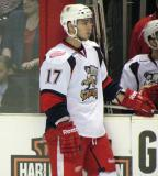 Max Nicastro stands at the bench during a stop in play in a Grand Rapids Griffins game.