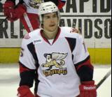 Mitch Callahan skates onto the ice during a stop in play in a Grand Rapids Griffins game.