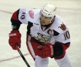 Jeff Hoggan chases after the puck during a Grand Rapids Griffins game.