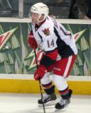 Chad Billins plays the puck along the boards during a Grand Rapids Griffins game.