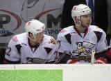 Louis-Marc Aubry and Max Nicastro sit on the bench during a stop in play in a Grand Rapids Griffins game.