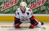 Chad Billins stretches on the ice prior to the start of the third period of a Grand Rapids Griffins game.