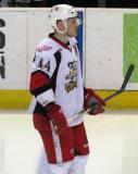 Brennan Evans stands at the blue line during a stop in play in a Grand Rapids Griffins game.