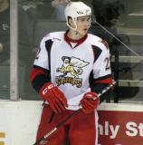 Louis-Marc Aubry stands along the boards during a stop in play in a Grand Rapids Griffins game.