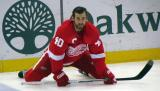 Henrik Zetterberg stretches on the ice during pre-game warmups.