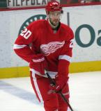 Drew Miller skates at the blue line, looking towards the goal, during pre-game warmups.