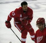 Pavel Datsyuk skates near Damien Brunner during pre-game warmups.